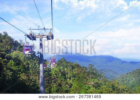 GENTING HIGHLANDS, MALAYSIA - DECEMBER 21 : Tourists travel on cable car of Genting Skyway. It is a gondola lift connecting Gohtong Jaya and Genting Highland. poster