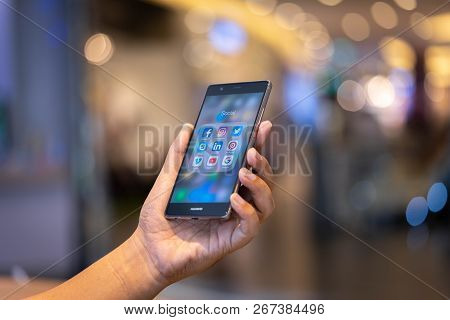 Chiang Mai, Thailand - Oct. 28,2018: Man Holding Huawei With Icons Of Social Media On The Screen. So