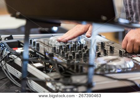 Deejay Uses Controls At Event To Entertain And Amuse