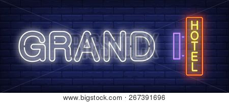 Grand Hotel Neon Sign. Hotel Signboard On Brick Wall Background. Vector Illustration In Neon Style F