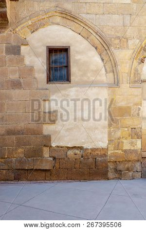 Front View Of Grunge Stone Bricks Wall And Small Window At Darb Al Ahmar District, Cairo, Egypt