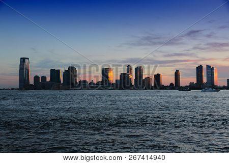 Jersey City, United States - Nj Downtown Skyline With Hudson River. Sunset Light.