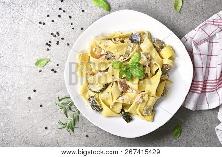 Delicious Pasta Dish With Ricotta Sauce And Fresh Herbs. Tagliatelle Noodles On A White Plate, Itali