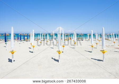 Alimini Grande, Apulia, Italy - Folded Sunshades At The Beautiful Beach Of Alimini Grande