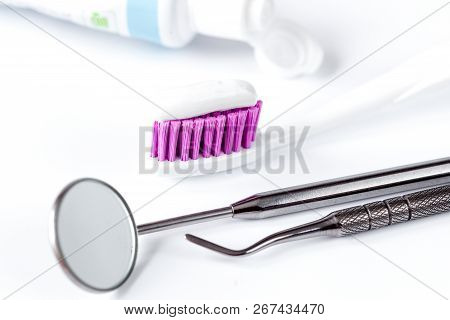 Dental Care Toothbrush With Dentist Tools On White Background