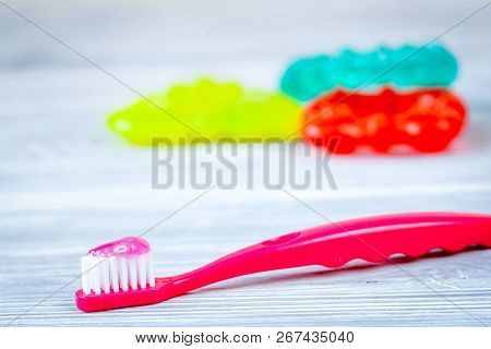 Childrens Toothbrush Oral Care On Wooden Background