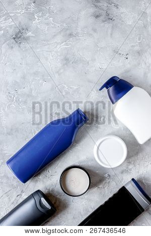 Cosmetic For Men In Bottle On Gray Background Top View