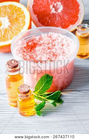 Organic Cosmetic With Citrus On Wooden Background