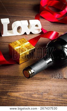 Concept Valentine Day With Wine At Wooden Background