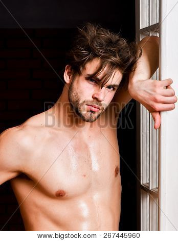 Sexy Attractive Macho Tousled Hair Coming Out Through Bedroom Door. Guy Attractive Lover Posing Sedu