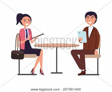 Businessperson Man And Woman Dressed In Formal Cloth Sitting At Round Table And Discussing Business