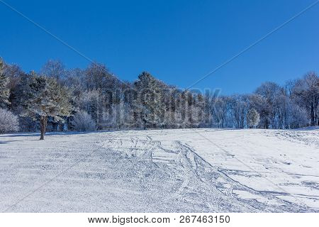 Winter Landscape With Snow Slope For Sledding, Tubing And Snowmobiling In The Early Morning
