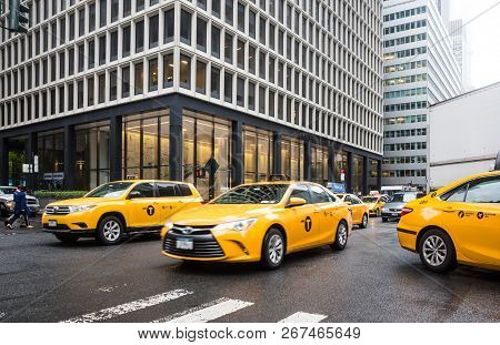 New York, Usa - May 03, 2016: Yellow Taxi On Street Of Manhattan In New York. City Street Scene With