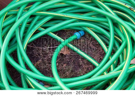 Top View Of Hosepipe On Grass, Minimalistic Conception.
