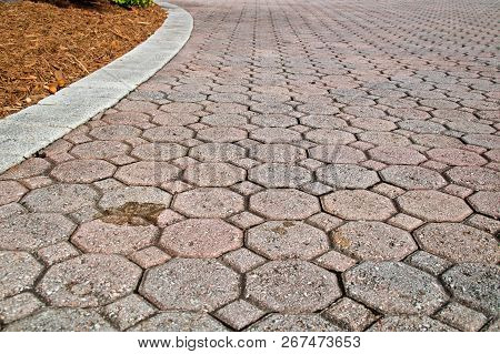 Low Angle Stained Brick Paver Driveway