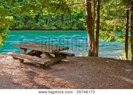 A picnic table with gorgeous view at river.