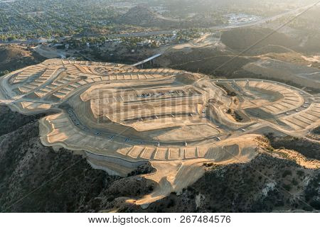 Aerial view of hilltop construction grading above the San Fernando Valley in Los Angeles, California.