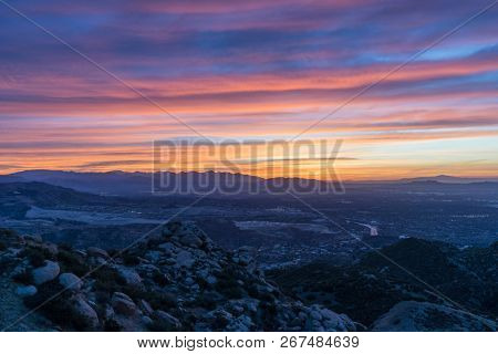 Rocky Peak Park hilltop sunrise view of the San Fernando Valley in Los Angeles California.  The Porter Ranch, Chatsworth, Northridge and the San Gabriel Mountains are in background.