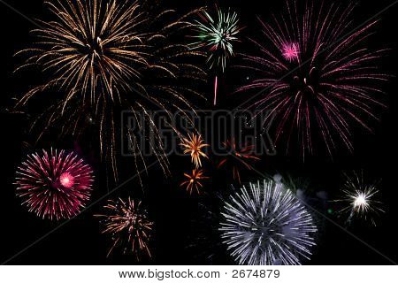 Assorted Bright And Colourful Fireworks Exploding In The Sky