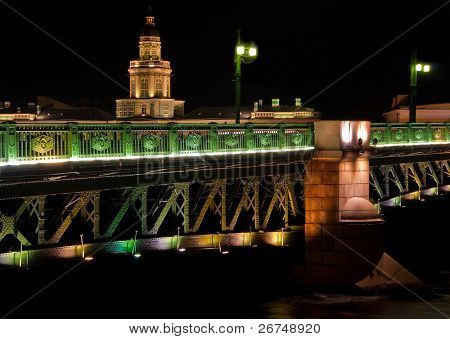 Majestic night view at Palace Bridge and Kunstkamera in Saint Petersburg, Russia in the night.
