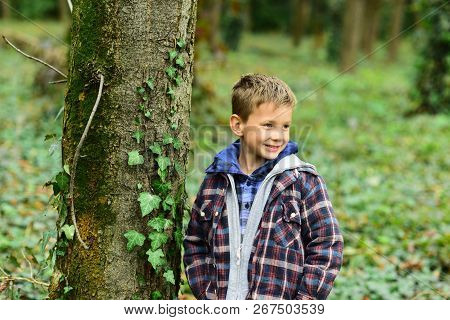 Funny And Cute. Funny Kid. Small Kid Play In Woods. Small Boy Have Fun Outdoor. Being Funny I Can Ma