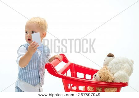 Savings On Purchases. Little Boy Child In Toy Shop With Credit Card. Shopping For Children. Little B