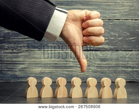 The Leader Holds His Finger Down Over The Team. Dismissal Of An Employee. Staff Cuts. Low Productivi