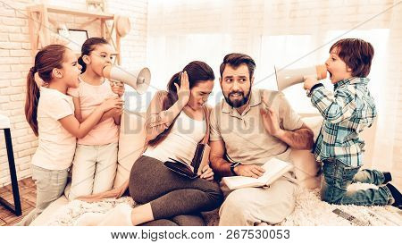 Naughty Children Annoying Parents Reading Book. Naughty Children Annoying Parents. Kids Playing With