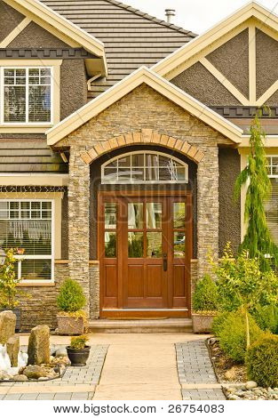 Entrance of a nice house with outdoor landscape.