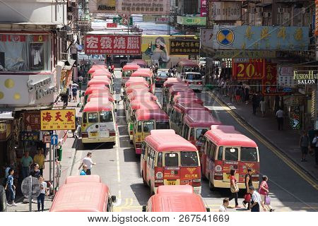 Hong Kong, China - August 14, 2017: Minibuses Lining Up, Waiting For Passengers At A Busy Station In