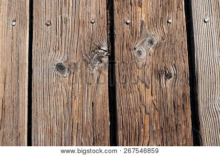 Aged Wooden Planks Nailed To A Boardwalk With Knots