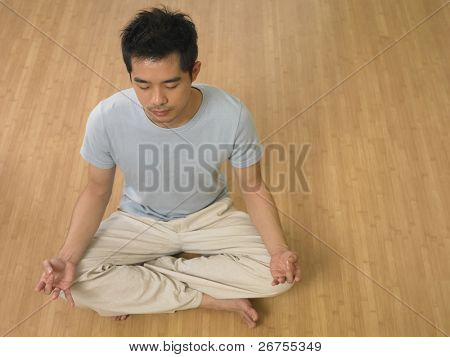 high angle shot of man practicing yoga at home
