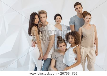 Friendship And Relationship Concept. Group Of Young Multi-ethnic Beautiful People Wearing Casual Clo