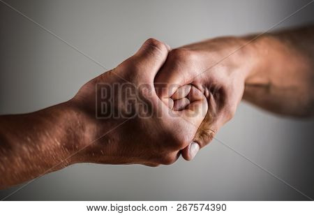Male Hand United In Handshake. Man Help Hands, Guardianship, Protection. Two Hands, Isolated Arm, He