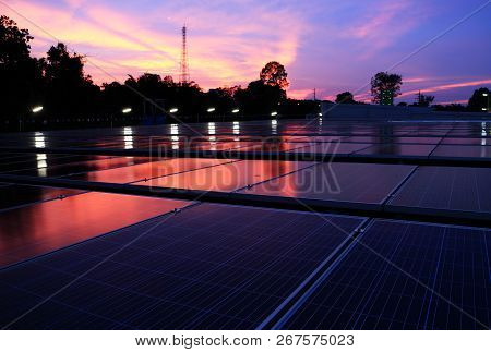Solar Pv Rooftop At Dawn With Red And Blue Cloud On The Sky