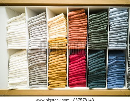 Multi-colored T-shirt Folded In The Lining Of The Shopping Mall.