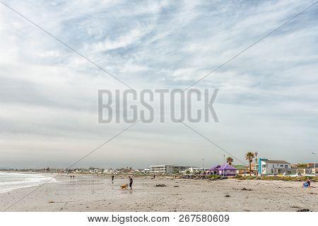 Melkbosstrand, South Africa, August 19, 2018: A Beach Scene In Melkbosstrand In The Western Cape Pro