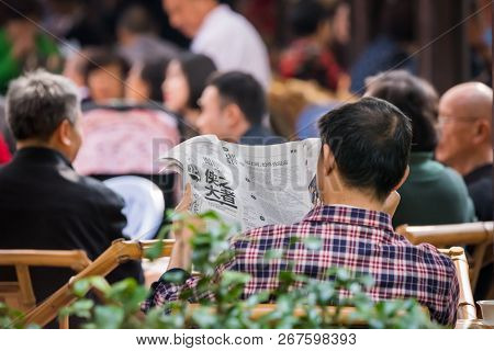 Chengdu, Sichuan Province, China - Oct 31, 2018 : Man Reading His Newspaper In The Morning In People
