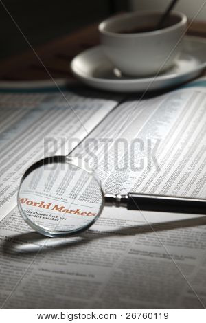 magnifier and coffee cup