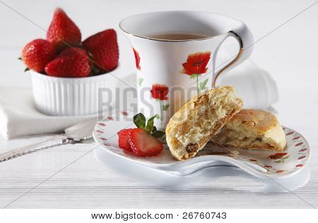 Scones decorated with strawberry and coffee.