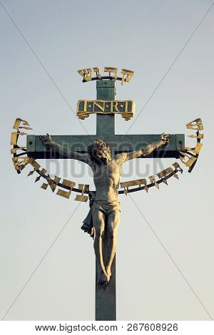 Beautiful Jesus Christ Crucifixion Bronze Statue During Sunrise, Statuary Of The St. Cross With Calv