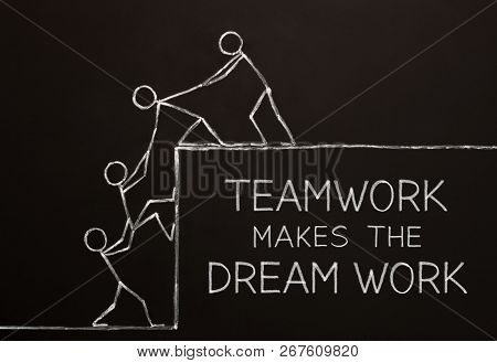 Concept Of A Business Team Working Together To Accomplish Their Dream Drawn With Chalk On Blackboard