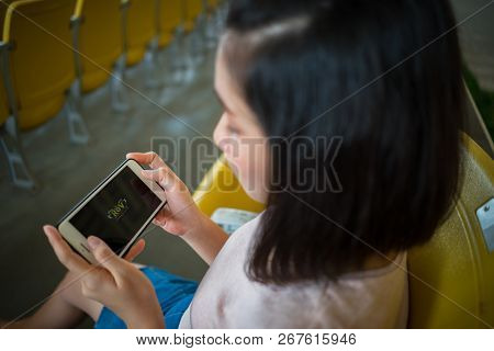 Zhuhai, China - September 28, 2018: Young Woman Playing Rov Online Computer Game On Smartphone. Teen