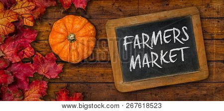 A Rustic Wooden Background With Autumn Foliage - Farmers Market