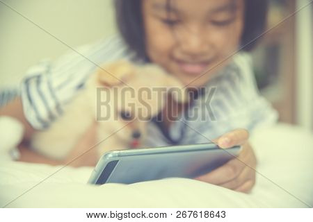 Friendship,relationship And Best Friend Concept.relationship Of Cute Little Girl And Chihuahua Dog,l
