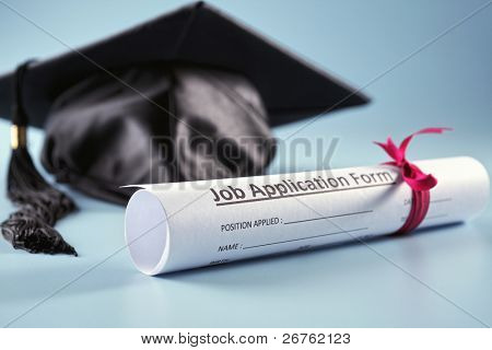 stock image of the mortar board and job application form