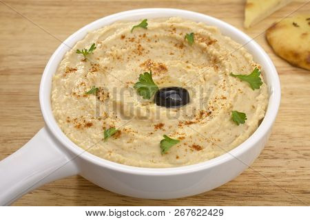 Middle Eastern Dip Hummus, Drizzled With Olive Oil, Sprinkled With Paprika And Scattered With Parsle