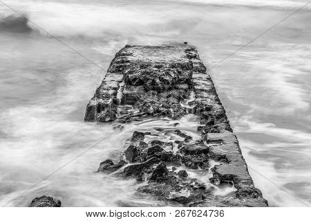 Old Pier In The Sea In Black And White