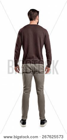 An Adult Man In Casual Sweater Stands In A Back View With Relaxed Arms And His Head Slightly Bent Si
