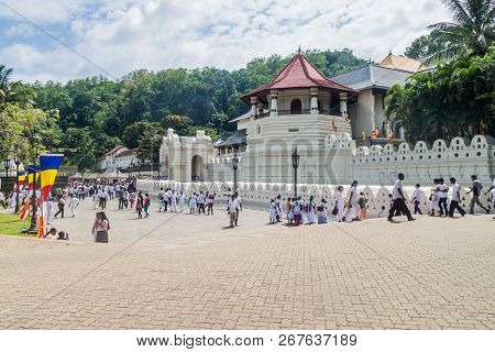 Kandy, Sri Lanka - July 19, 2016: White Clothed Buddhist Devotees Visit Temple Of The Sacred Tooth R